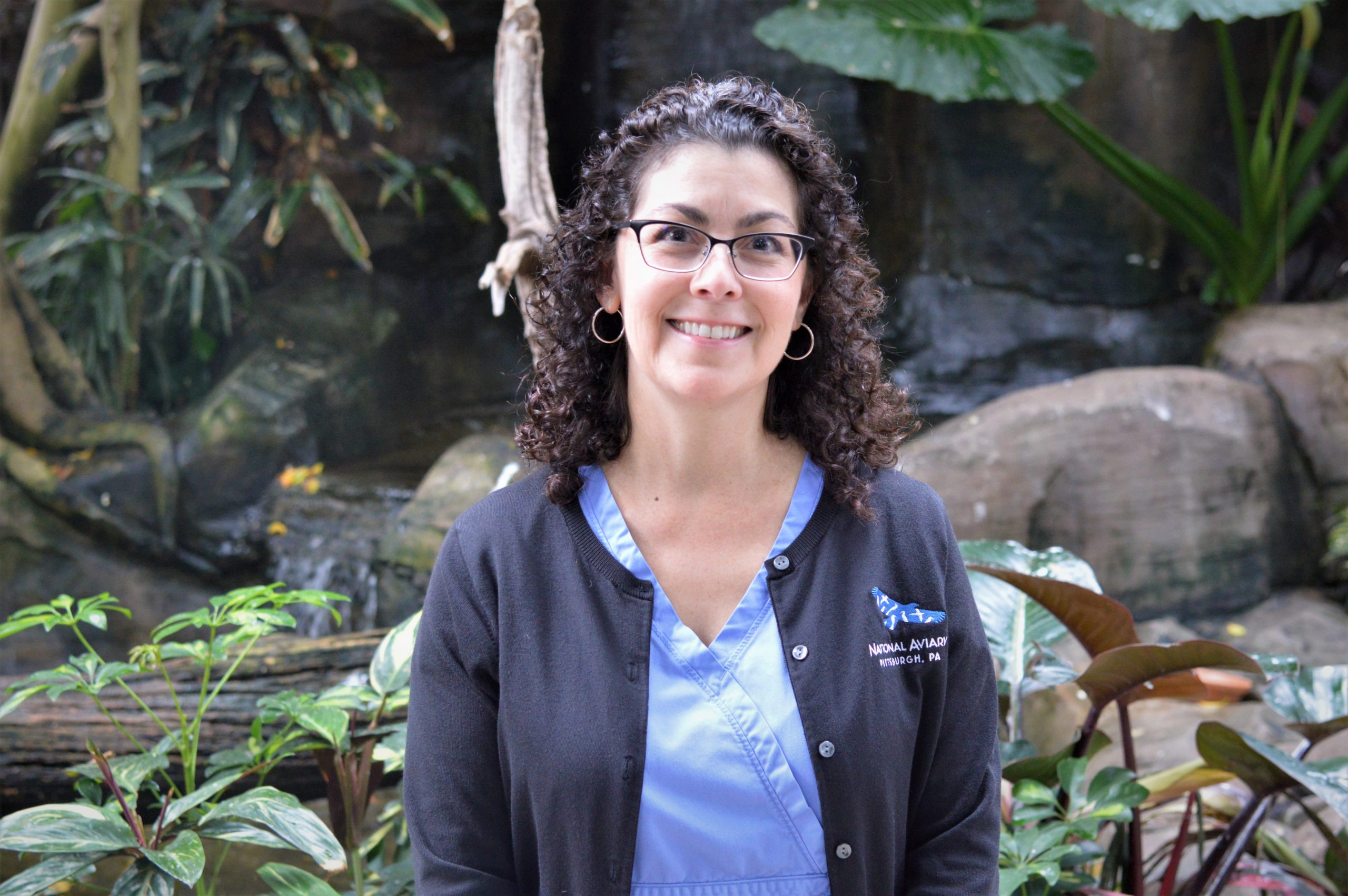 Dr. Pilar Fish in front of a waterfall